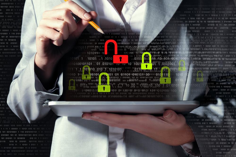 Businesswoman-holding-tablet-pc-entering-password.-Security-concept-1